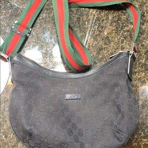 black Gucci messenger bag